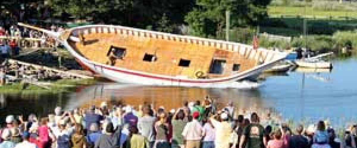 A ship turned over on its side at The Essex River Cultural District.