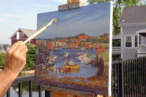 Artist painting a beautiful picture of Gloucester's harbor.