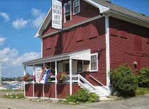 Exterior view of the Gallery-On-The-Moors, located on Ledge Road in East Gloucester. It looks like a red barn.
