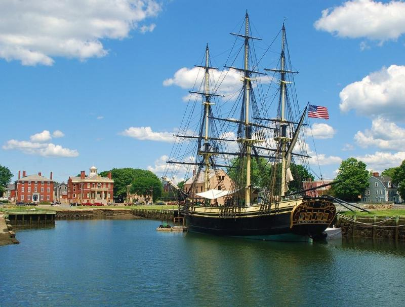 A old historic sailboat floating in the harbor of the Salem Maritime National Historic Site.