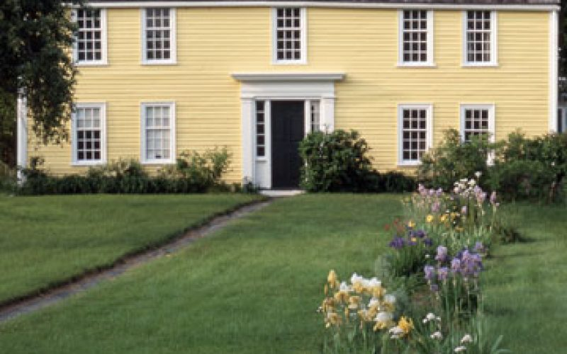 Yellow House with big front lawn is known as the Paine House and Greenwood Farm.