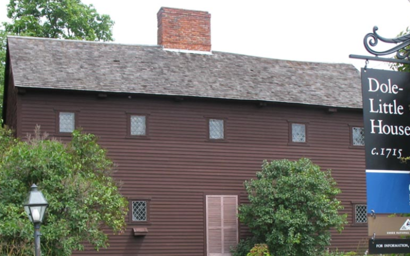 Brown house with brick chimney called the Dole-Little House made in 1715.