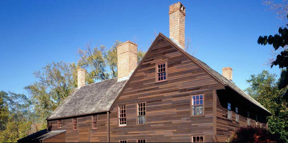 Wooden house with three chimneys known as the Coffin House.