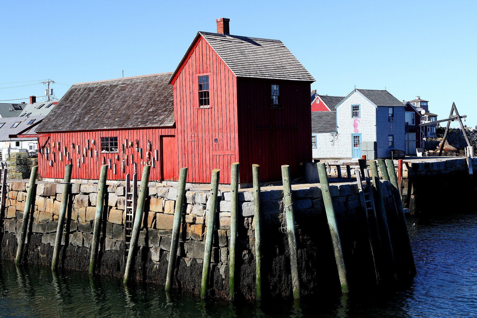 Barn on ocean representing the city of Rockport.